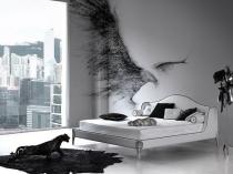 Белая спальня с эффектными элементами декора черного цвета