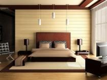 Декоративные стеновые панели в отделке бежево-коричневой спальни