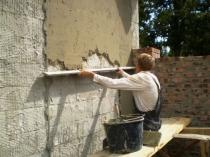 Нанесение цементной штукатурки на армирующую сетку
