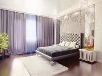 Бледно-сиреневые шторы под цвет мягкой мебели спальни