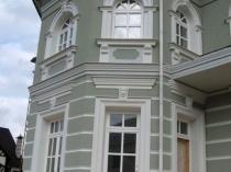 Фасад дома после отделки фактурной штукатуркой