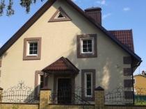 Загородный дом с использованием штукатурки для отделки фасада