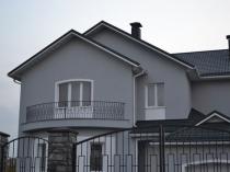 Отделка фасада дома цементной штукатуркой