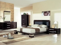 Невысокая мебель в интерьере спальни в стиле модерн