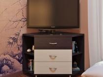 Угловой комод-тумба под телевизор для спальни