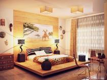 Кровать на подиуме в красивой спальне в этно стиле