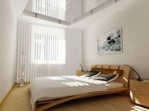 Маленькая спальня с отделкой стен в светлых тонах