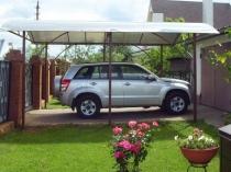 Установка на участке загородного дома навеса для автомобиля