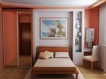 Компактная мебельная стенка с рабочим местом в малогабаритной спальне