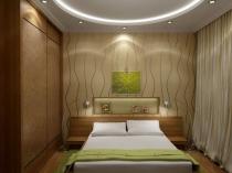 Спальня после ремонта с удобным расположением кровати