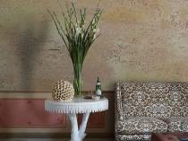 Декоративная штукатурка Травертино в создании интерьера гостиной