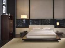 Спальня модерн с темной отделкой пола и стен