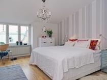 Белая спальня в скандинавском стиле оформления