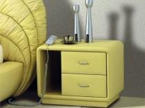 Оригинальная прикроватная тумба с мягкой обивкой в цвет кровати спальни