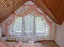 Декорирование арочного проема окна тюлевыми шторами
