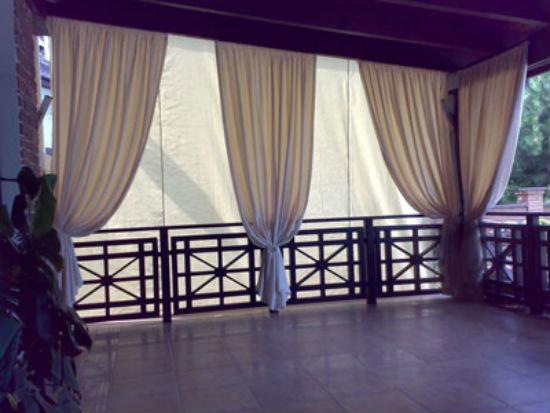 Текстильные шторы в беседке