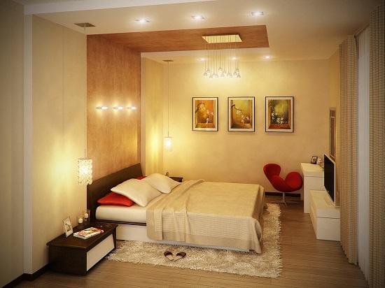 Зонирование узкой спальни декоративной вставкой на стене и потолке