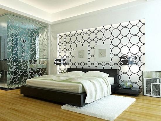 Спальня  с красивой отделкой стены и шкафа