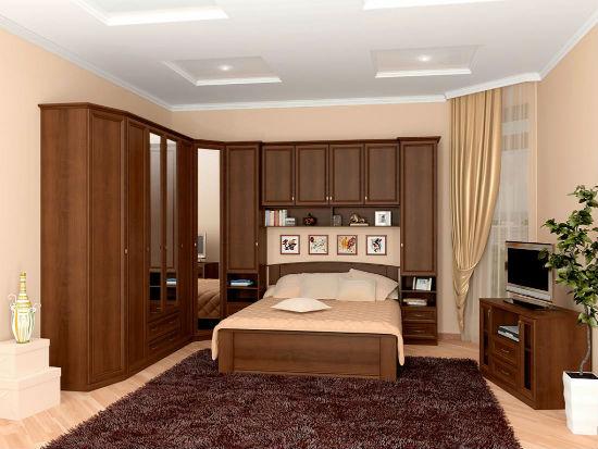 Мебельная стенка со встроенной кроватью в спальне