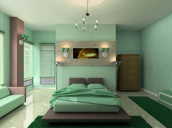 Фисташковые оттенки в декоре стен и мягкой мебели спальни