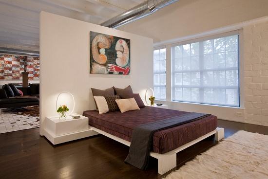 Использование декоративной перегородки для зонирования спальни гостиной