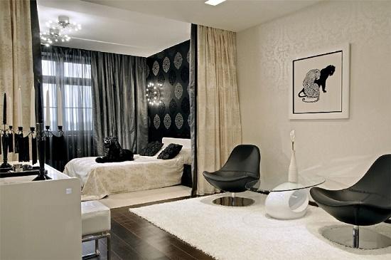 Разделение на зоны спальни гостиной при помощи дизайна в черно-белых тонах