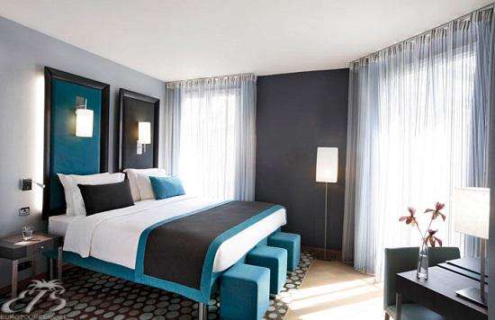 Серый и бирюзовый тона в оформлении спальни