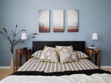 Модульные картины над кроватью в спальне