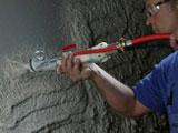 Механизированная штукатурка стен комнаты