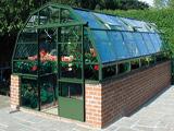 Зимняя теплица арочной конструкции с кирпичными стенками